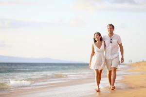 bigstock-Couple-walking-on-beach-Young-40788364